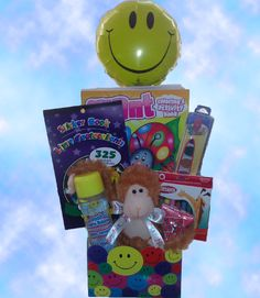 #Kids #Birthday Basket-This basket is a wonderful birthday gift for any girl or boy! It contains various art supplies such as crayons, paint, and a coloring book, as well as bubbles, stickers, a ring pop, smiley face balloon, and a cute plush happy birthday monkey! (Ages 3-7)
