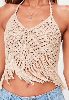 this knitted top features a cropped length, halter neck style, tassel details at the trim and a crochet design.