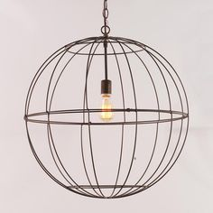 Wire Globe Lantern:  DIY - put two dollar store metal planters together, insert a light kit, and you have a Wire Globe Lantern for under 10 bucks!