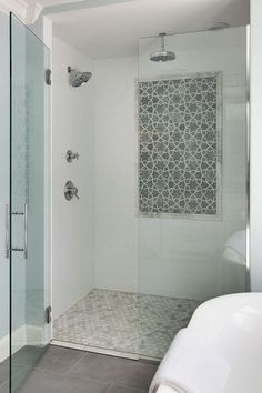 The shower features a classic combination of marble and white subways tiles. Grace Hill Design