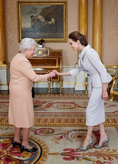 Queen Elizabeth II presented Actress Angelina Jolie with the Insignia of an Honorary Dame Grand Cross of the Most Distinguished Order of St Michael and St George in the 1844 Room on 10.10.2014 at Buckingham Palace, London.