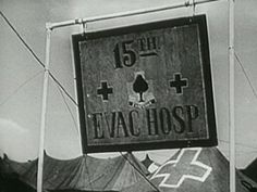 Entrance sign to the 15th Evacuation Hospital establishment taken during the unit's stay in Anzio. The photograph was taken on February 12, 2 days following the unit's arrival in the area. Of special interest are the markings on the M1943 Pyramidal Tent in the background. This is not the usual white circle with red cross.