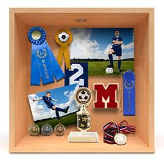 Sports Shadow Box - A shadow box is a great way to bring all the season's best moments together. Combine memorabilia with photos of your athlete from Kodak Picture Kiosk.