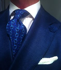 Blue double breasted sports coat by Suitsupply with white TM Lewin shirt and a vintage silk Gucci tie, white silk square Charvet & boutonnière by hook & ALBERT