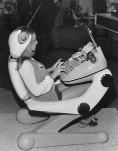 Vintage Futuristic chair - would love something like this retro-fitted for a laptop! Looks like it has built in headphones?