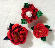 Three red kanzashi clips