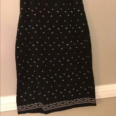 Long skirt Cold water creek poly and rayon blend long skirt . Elastic in sides and back zipper and kick pleat. Pretty black with white embroidery. Coldwater Creek Skirts Maxi