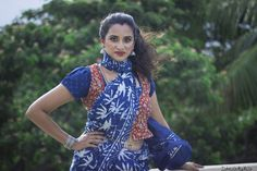Style a vest over a blouse for a more edgy look.  This is a kalamkari vest with an indigo dye sari and blouse.