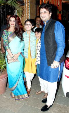 Sonali Bendre and Goldie Behl with their sons at Amitabh Bachchan's Diwali bash.