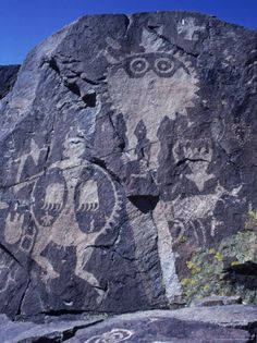 Ancient Pueblo-Anasazi Rock Art of a Warrior with a Bear Claw Shield. New Mexico