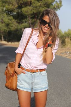 Preppy but casual.  light pink striped button-down collar shirt with light wash high waistd jean shorts and light brown buckle belt and large hipster