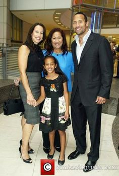 Dwayne Johnson (The Rock), with his former wife Dany Garcia, their daughter Simone,  his mother Ata Maivia Johnson