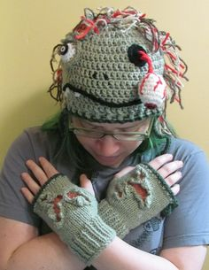Zombie earflap hat knit and crochet shredded flesh and dangling eyeball ready to ship