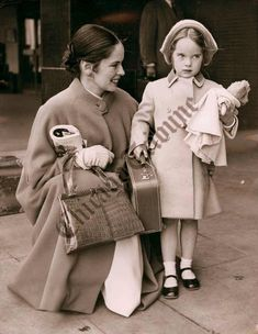 "chaplinfortheages: ""This very adorable little girl is 5 year old Victoria Chaplin. Picture from Chicago Tribune - April 1956 Victoria (with her mother Oona), arriving at London Airport from Switzerland, her father Charlie Chaplin was working on his..."