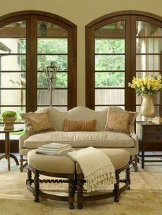 creamy rug and grouped ottoman coffee table . . .  what do you think?  this would get some light fabric in your room.