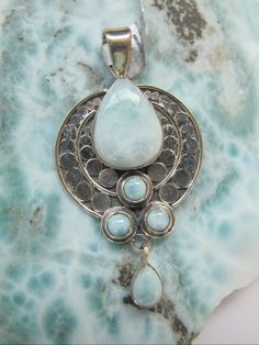 Gorgeous handmade artisan Caribbean Larimar and Sterling gemstone pendant with large teardrop Larimar center stone and 4 small round Larimar accent stones, bezel-set in 925-hallmarked sterling silver.