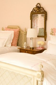 shared girls room. subtle, warm pinks with golden brown and cream.