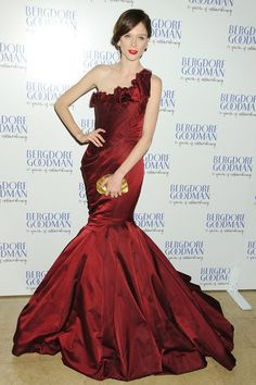 OCTOBER 18 2012 - Coco Rocha wore a pre-spring/summer 2013 burgundy Zac Posen dress and carried a gold clutch to attend Bergdorf Goodman's 111th anniversary party.
