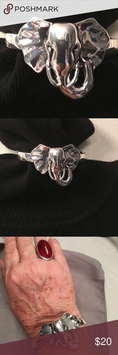 """Elephant Bracelet bangle silver tone Elephant Bracelet bangle silver tone. Never been worn. Elephant is approximately 2"""" wide x 1 6/8"""" long. And approximately 8"""" around. Fashion bracelet. Jewelry Bracelets"""