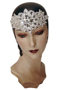 Our Crystal Marquise Headband adds deco chic to any outfit! Made of handmade applique with shimmering diamante and rhinestones. Looks fabulous with modern looks, as well as vintage-wear. One size fits