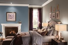 An accent wall coated in Behr's Cold Steel pops against white trim painted in Creme de la Creme.