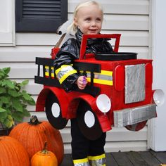 recycled cardboard and upcycled clothing firetruck costume in contest on @inhabitot