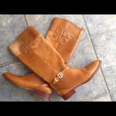 TORY BURCH RIDING BOOTS Tall Tory Burch Boots.  Suede and leather riding boots.  Tory Burch monogram canvas lining.  Dual shades of brown.  Slight discoloration on upper suede patches. As shown in third picture and taken into consideration in pricing.  Lots of love left in these great boots.  Gain lots of compliments. Tory Burch Shoes Ankle Boots & Booties
