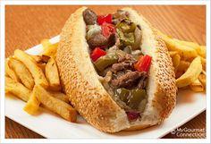 Philly-Style Steak Sandwich ~ tender NY strip steaks, roasted peppers, sauteed onions, mushrooms & provolone cheese
