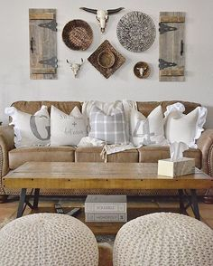 Mixed baskets, antique shutters and a longhorn, rethink your gallery wall with a southwestern twist with rustic touches paired with wooden and knit details a la @cghomeinteriors | Get read-to-shop #LTKhome details with www.LIKEtoKNOW.it | http://liketk.it/2pZut #liketkit