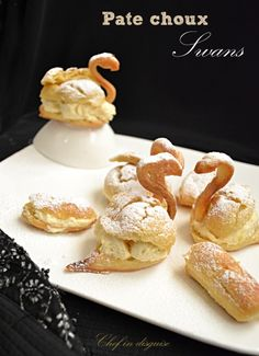 filled pate a choux swans with a step by step on how to make them @Chef in disguise