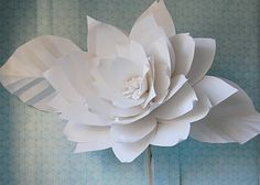 Chanel show inspired huge large white paper flowers backdrop