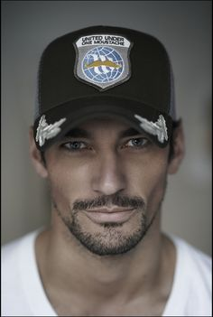 """David Gandy wearing a custom Lucky Seven cap during """"Movember"""" (No Shave November), a movement promoting men's health and during which vital funds and awareness are raised to combat prostate and testicular cancer and mental health challenges. November 2103.  Photographed by Rich Hardcastle."""