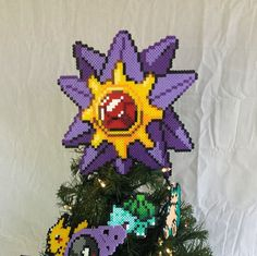 Product Details: This is a 100% handmade Starmie tree topper! It is made out of plastic beads that have been fused together. It is about 9 inches