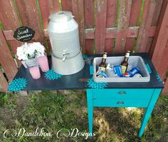 """Vintage sewing cabinet turned into a beverage cart- Base is painted in Waverly brand chalk paint in """"Peacock"""", Top painted in Rustoleum """"Deep Navy"""" Sealed with Spar Polyurethane to withstand the elements"""
