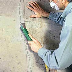 Do your concrete walls have cracks? Discover a simple, effective way to patch cracks in poured-concrete walls from the experts at This Old House today. Basement Remodel Diy, Basement Remodeling, Basement Ideas, Remodeling Ideas, Basement Waterproofing Paint, Repair Cracked Concrete, Cinder Block Walls, Foundation Repair, House Foundation