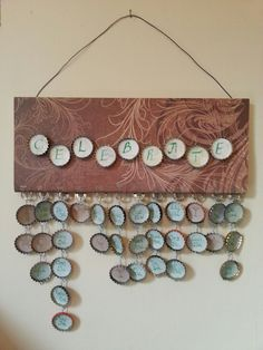 My own family birthday display made from bottle caps, ring pulls, wire, a cheap plaque from the b&q sale, my calligraphy kit, sharpies and some decorative paper. Job done.