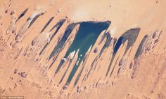 Ounianga Lakes, Sahara Desert, Chad: The lakes are situated in a shallow basin below sandstone cliffs and hills, from where the ancient water flows, sustaining the largest permanent freshwater lakes in such an arid desert environment anywhere in the world