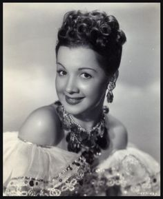 """Olga San JUAN '40-50 was an American actress, born in Brooklyn of Puerto Rican parents. Actress, dancer and comedian, mainly active in films during the 1940s. She was dubbed the """"Puerto Rican Pepperpot"""". She appeared in  singing and dancing roles alongside Bing Crosby, Fred Astaire and others."""