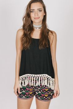 63f85621da2fb9 This piece is Viscose Sleeveless tank with open back Featuring adjustable  shoulder straps and fringe hem Model is wearing a size S Hand wash cold