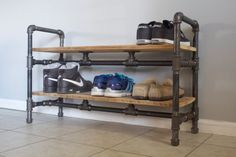 Buy or make yourself https://www.etsy.com/listing/212310191/shoe-rack-made-from-reclaimed-barn-wood?ref=sr_gallery_6