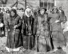 """This photo was taken in Washington, D.C. in 1916 at the """"Convention of Former Slaves.""""   Pictured from left to right: Annie Parram, age 104; Anna Angales, age 105; Elizabeth Berkeley, 125; Sadie Thompson, 110."""