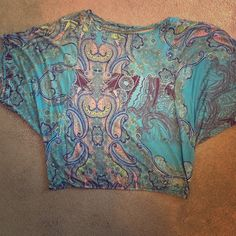 Paisley print batwing top Lightweight crop-like (or hits at waist) top by Weston Wear. Blues, yellow, peach colors. Elastic at waist. Large, but easily fit med./small Weston Wear Tops Blouses