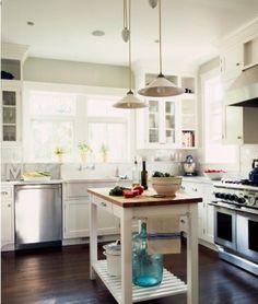 white kitchen, butcher block island.