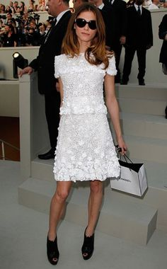 Elisa Sednaoui in a white floral Chanel Haute Couture dress + black Christian Louboutin heels