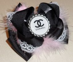 Chanel Inspired Couture double Stacked black with pink fur Boutique Hair Bow With white CC bottlecap, white lace. $7.99, via Etsy.