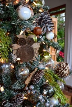 rustic tree decor. owls and pinecones