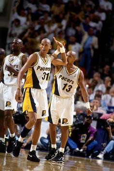 Mark Jackson #13 and Reggie Miller #31 of the Indiana Pacers high five each other in Game Six of the Eastern Conference Finals against the Orlando Magic during the 1995 NBA Playoffs on June 2, 1995 at Market Square Arena