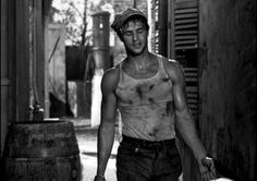 Marlon Brando gets his hands dirty as he is pictured in a dirty wifebeater.