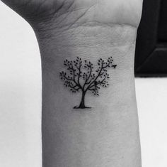 Small Tree Tattoo on Wrist by Cesar Paradiso