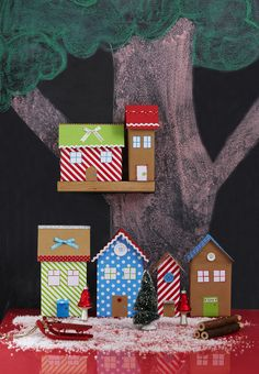 Create a Christmas play-town with recycled boxes and leftover wrapping paper suzieattawayhomestylist.com/blog